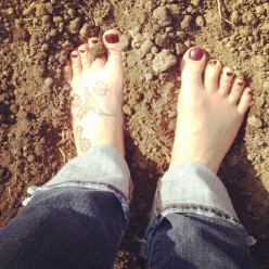"""My flat and square """"Fred Flinstone"""" feet getting happy in the lovely soil of John's garden."""