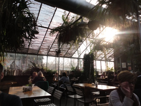 The dining room is like a giant terrarium filled with seasonal plants and sunlight