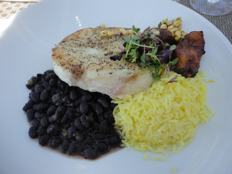 Grilled grouper with saffron rice, black beans, and plantains. Simply delicious.