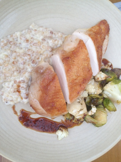 Chicken confit with barley risotto and roasted brussels sprouts. Holla!
