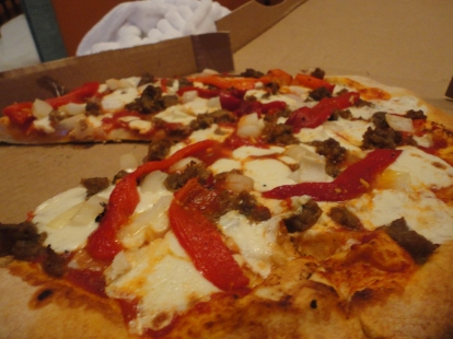 The pizza in question with house made mozzarella, sausage, roasted red peppers and onions