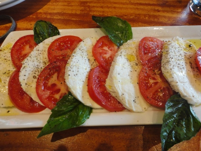 Caprese Salad with house made mozzarella. No, tomatoes are not in season yet, but these tomatoes were tasty and this salad was worth the non-local splurge