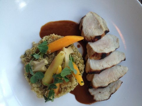 Pork with quinoa, baby carrots,  roasted artichokes and garlic jus